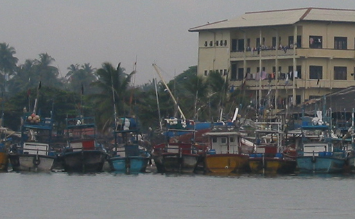Fishing pier with Sula's mast behind the fishing boats
