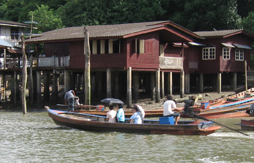 People going to market in a long tail boat