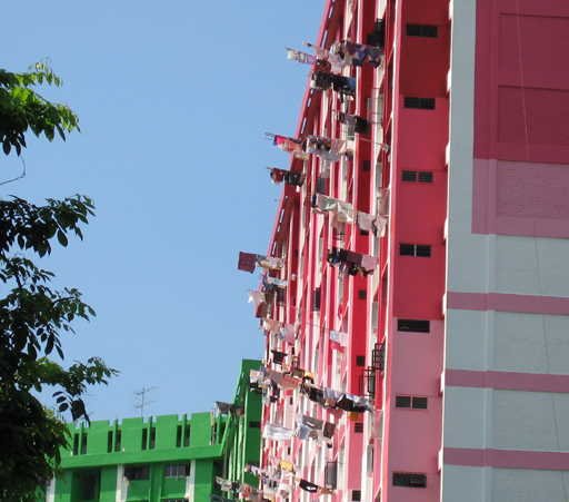 Laundry hanging from apartment block windows