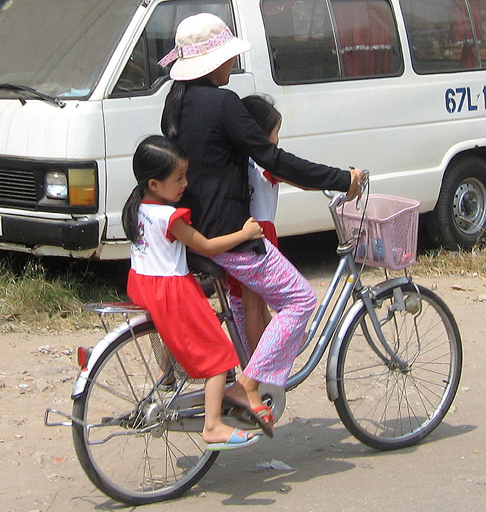 Mother and kids on a bicycle