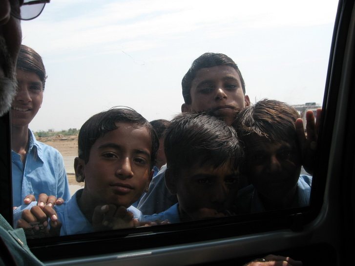 School boys looking in our car window