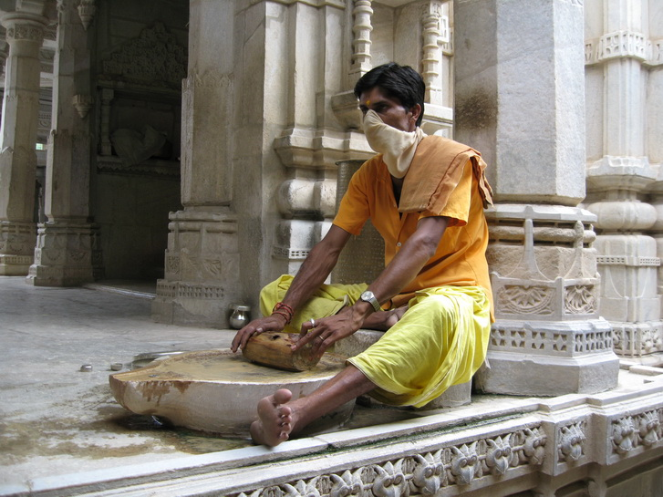 Monk making sandalwood paste