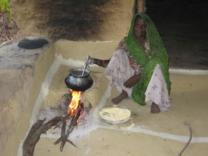 Preparing the daily meal on an open fire