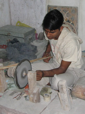Man hand carving semiprecious stone