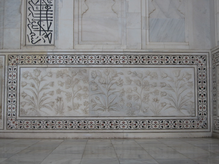 Carved and inlayed marble of the main tomb of the Taj