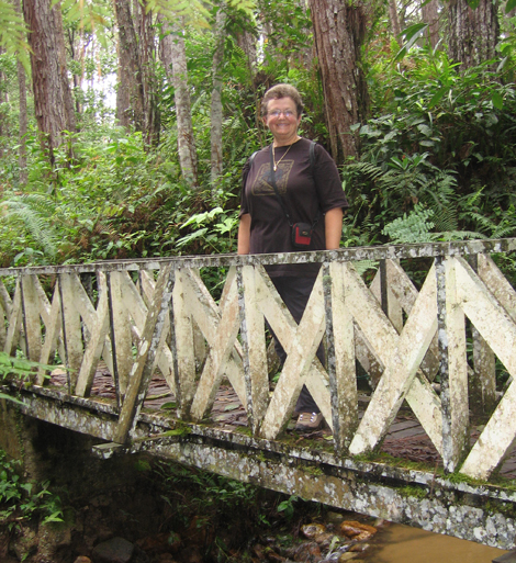 Jane on a lichen covered bridge