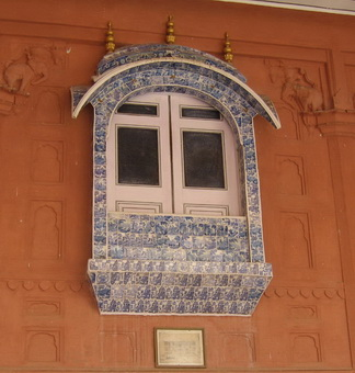 Window decorated with Delft tiles.