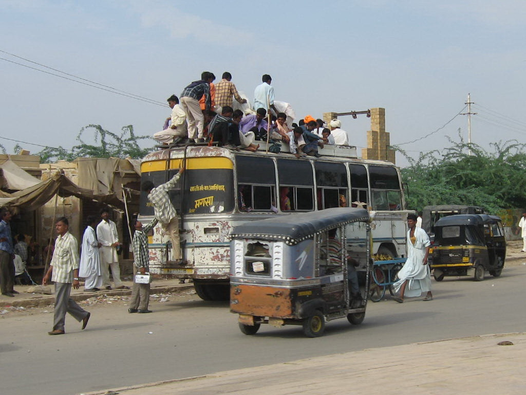 Bus with passengers on top
